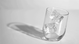 Two ice cubes in a super slow motion rebounding in Footage