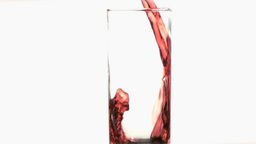 Red thin trickle in a super slow motion flowing in Stock Video Footage