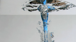 Brush in a super slow motion falling on water agai Footage