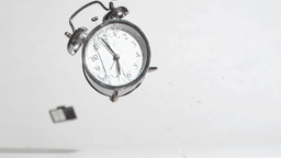 Alarm clock sounds in a super slow motion crushing by a hammer Footage