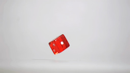 One red dice in super slow motion turning near the Footage