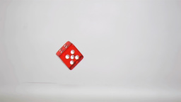 One red dice in a super slow motion rebounding and Footage