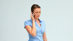 Welldressed woman calling with a mobile phone Footage