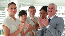 Smiling business people applauding Stock Video Footage