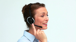 Welldressed woman speaking with a headset, Live Action