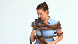 Businesswoman attached with a rope Footage