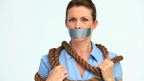 Businesswoman attached with a rope and having tape Footage