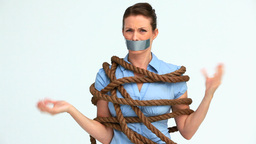 Woman with tape on the mouth and attached with a r Footage