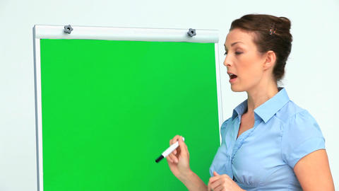 Businesswoman giving a presentation with a board Footage
