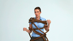Woman attached with a rope Stock Video Footage