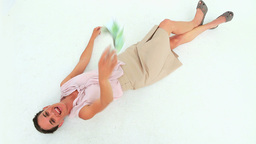 Welldressed woman lying on the floor throwing bank Stock Video Footage