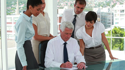 Business team around their boss whos writing on a Stock Video Footage