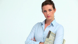 Serious business woman with a newspaper crossing h Stock Video Footage