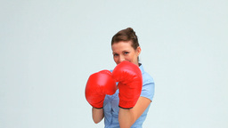 Businesswoman boxing in front of the camera Stock Video Footage