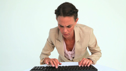Businesswoman typing on a keyboard and on the came Footage