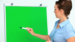 Businesswoman giving a presentation using a board Stock Video Footage