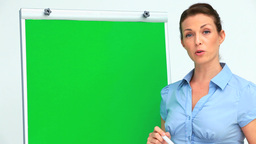 Businesswoman giving a presentation using a board Footage