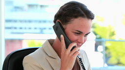 Businesswoman with tied hair on the phone Stock Video Footage