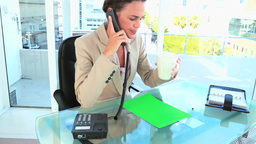 Woman on the phone file copy space file on her desk Live Action