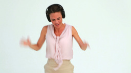 Welldressed woman dancing with headphones, Live Action