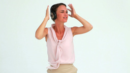Welldressed woman dancing with headphones Footage