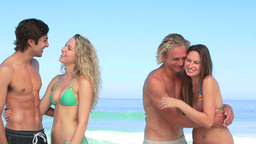 Two couples embracing together Stock Video Footage