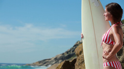 Woman holding a surfboard Stock Video Footage