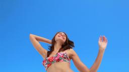 Woman happily dancing in a bikini Stock Video Footage