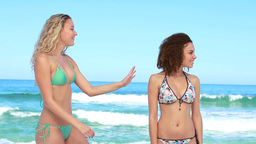Two women meet up at the beach Stock Video Footage