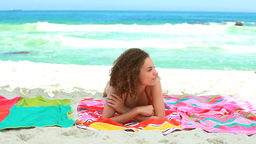 Woman lying on a beach towel Stock Video Footage