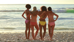A group of girls sand together and look at the wat Footage