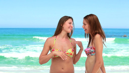 Two friends have fun together at the beach Stock Video Footage