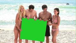 Four people holding onto a green screen Stock Video Footage