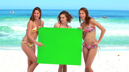 Women holding a blank poster while laughing Footage