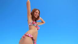 Girl happily dancing in her bikini Footage