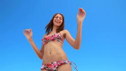Girl happily dancing in her bikini Stock Video Footage