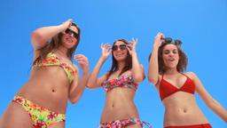 Three girls dancing together in bikinis Footage