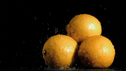 Lemons in super slow motion being soaked Stock Video Footage