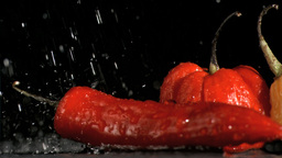 Peppers and chili in super slow motion receiving w Footage