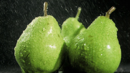 Raindrops in super slow motion falling on pears Footage