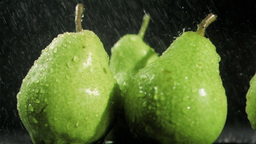 Raindrops in super slow motion falling on pears Stock Video Footage