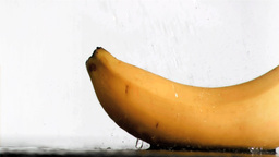 Delicious banana in super slow motion receiving wa Footage