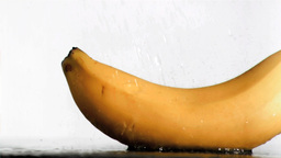 Delicious banana in super slow motion receiving wa Stock Video Footage