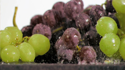 Purple and green grapes in super slow motion being Footage