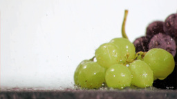 Colorful grapes in super slow motion being soaked Stock Video Footage