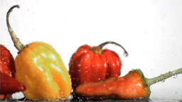 Vegetables in super slow motion being soaked Footage