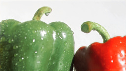 Tasty peppers in super slow motion being soaked Stock Video Footage