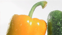 Colorful peppers in super slow motion receiving dr Footage