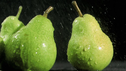 Delightful pears in super slow motion being soaked Stock Video Footage