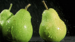 Delightful pears in super slow motion being soaked Footage